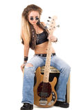 Donna con una chitarra. Roccia-N-rotoli lo stile Fotografie Stock Libere da Diritti
