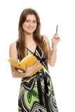 Donna con una matita ed il libro Fotografia Stock
