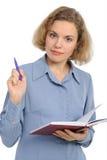 Donna con una matita ed il taccuino Immagini Stock
