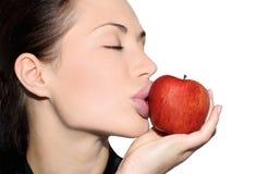 Donna con una mela Fotografia Stock