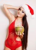 Donna con una noce di cocco Fotografie Stock Libere da Diritti