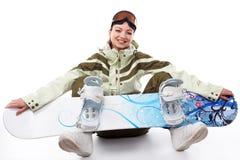 Donna con uno snowboard Immagine Stock
