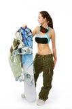 Donna con uno snowboard Fotografie Stock