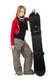 Donna con uno snowboard Fotografia Stock