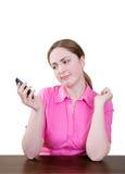 Donna confusa che lavora al pda Fotografia Stock