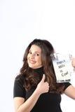 Donna cosciente di salute giovane con latte Fotografie Stock