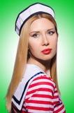 Donna in costume del marinaio Immagini Stock