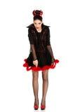 Donna in costume di carnevale del diavolo che indica giù Immagine Stock