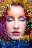 Donna in costume di Natale del lamé Immagine Stock