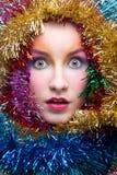 Donna in costume di Natale del lamé Fotografia Stock