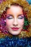 Donna in costume di Natale del lamé Immagini Stock