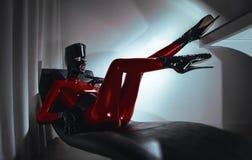 Donna in costume di rosso del fetsih del lattice fotografia stock