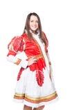 Donna in costume russo piega di tradizione Isolato su priorità bassa bianca Immagini Stock