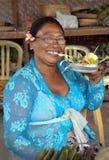 Donna d'offerta a Celuk, Bali Indonesia del fiore Immagini Stock Libere da Diritti