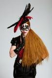 Donna dai capelli lunghi nella mascherina Fotografie Stock Libere da Diritti