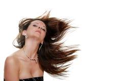 Donna del Brunette con il suo salto dei capelli fotografia stock libera da diritti