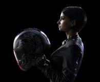 Donna del motociclista nel nero isolata Immagini Stock