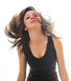 Donna del partito isolata con vento in capelli Fotografie Stock