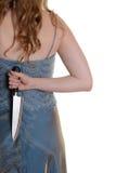 Donna del primo piano con il coltello dietro lei indietro fotografia stock libera da diritti