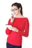 Donna dell'allievo che per mezzo del calcolatore del ridurre in pani Fotografia Stock