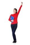 Donna dell'allievo con i taccuini che mostrano gesto di vittoria Fotografie Stock