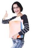 Donna dell'allievo con i taccuini che mostrano gesto giusto Fotografie Stock