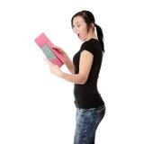 Donna dell'allievo con il rilievo di nota Fotografia Stock