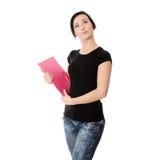 Donna dell'allievo con il rilievo di nota Fotografia Stock Libera da Diritti