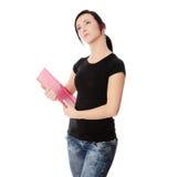 Donna dell'allievo con il rilievo di nota Immagine Stock Libera da Diritti