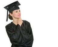 Donna dell'allievo di graduazione che osserva sullo spazio della copia Fotografie Stock Libere da Diritti