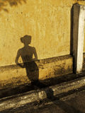 Donna dell'ombra Fotografie Stock