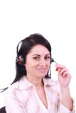 Donna dell'operatore di servizio di assistenza al cliente con lo smili della cuffia avricolare immagini stock libere da diritti