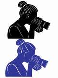 Donna della siluetta con la macchina fotografica Immagini Stock