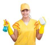 Donna delle pulizie in uniforme gialla immagini stock libere da diritti