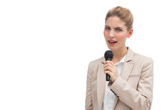 Donna di affari aggrottante le sopracciglia con il microfono Immagine Stock Libera da Diritti