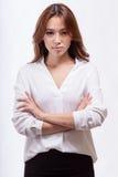 Donna di affari americana asiatica con le armi attraversate Fotografia Stock Libera da Diritti