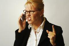 Donna di affari arrabbiata sul Ce Fotografie Stock