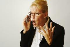 Donna di affari arrabbiata sul Ce Fotografie Stock Libere da Diritti