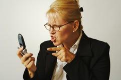 Donna di affari arrabbiata sul Ce Fotografia Stock Libera da Diritti