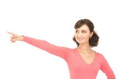 Donna di affari attraente che indica la sua barretta Fotografie Stock