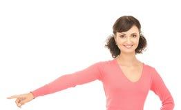 Donna di affari attraente che indica la sua barretta Immagine Stock Libera da Diritti