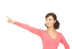 Donna di affari attraente che indica la sua barretta Fotografie Stock Libere da Diritti