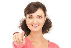 Donna di affari attraente che indica la sua barretta Immagini Stock Libere da Diritti