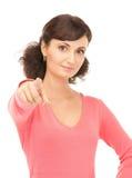 Donna di affari attraente che indica la sua barretta Fotografia Stock