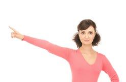 Donna di affari attraente che indica la sua barretta Immagini Stock
