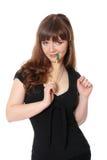 Donna di affari attraente con una penna Fotografie Stock Libere da Diritti