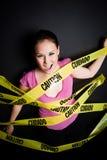 Donna di affari bloccata in nastro di avvertenza Fotografia Stock