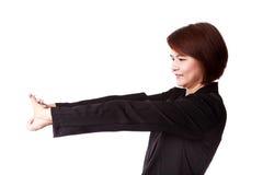 Donna di affari che allunga esercizio Immagine Stock
