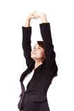 Donna di affari che allunga esercizio Immagini Stock