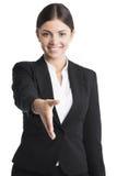 Donna di affari che allunga mano per stringere Immagini Stock